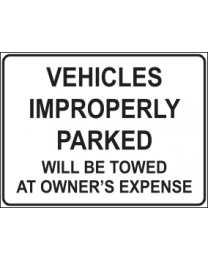 Vehicles Improperly Parked Will Be Towed At Owners Expense Sign