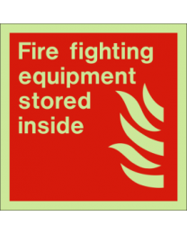 Fire fighting equipment stored inside sign